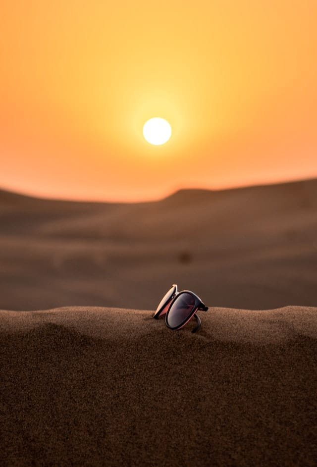 sunglasses on a san dune in the desert